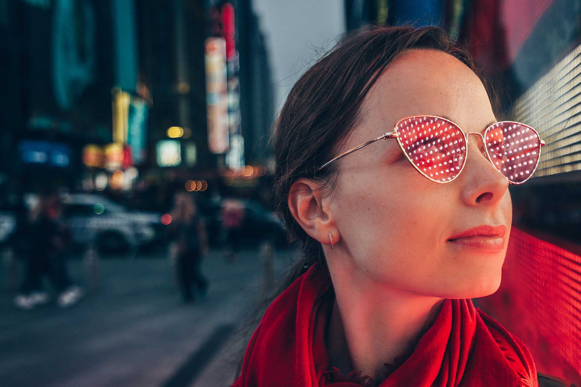 Young woman with a red glasses in the New York City.
