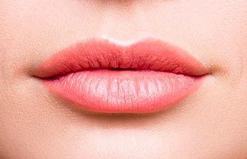 Close up cropped photo of attractive woman's lips without lipstick and after having shape correction she has expression wrinkles.